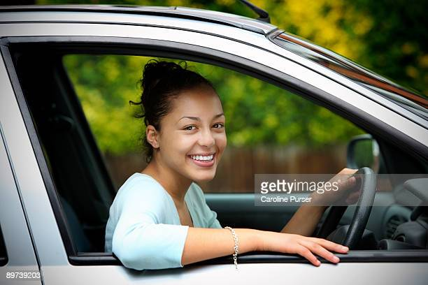 Mixed-race teenager learning to drive a car
