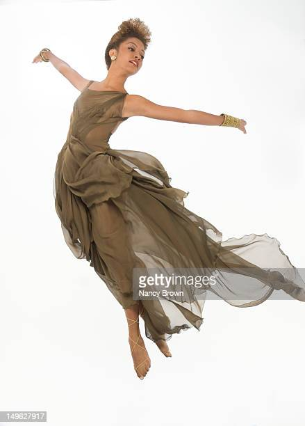 a mixed-race woman jumping for joy - tulle netting stock pictures, royalty-free photos & images