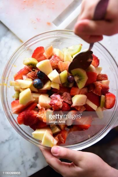 Mixing a fruit salad