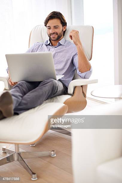 mixing business with leisure - reclining chair stock photos and pictures