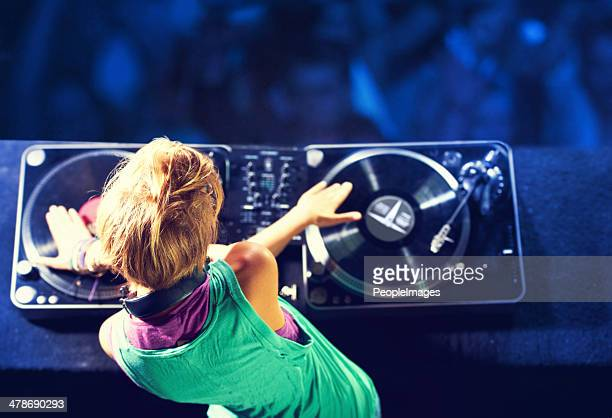mixing it up for the crowd - dj stock pictures, royalty-free photos & images