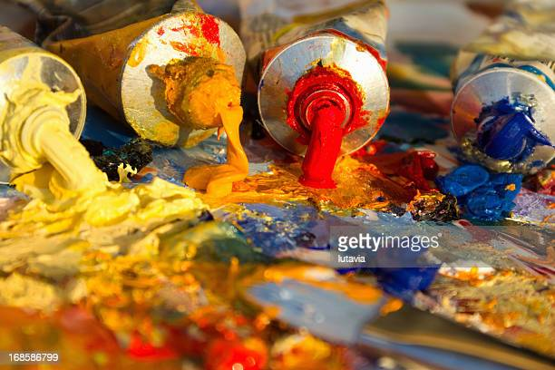 mixing oil paints with a brush - lutavia stock pictures, royalty-free photos & images