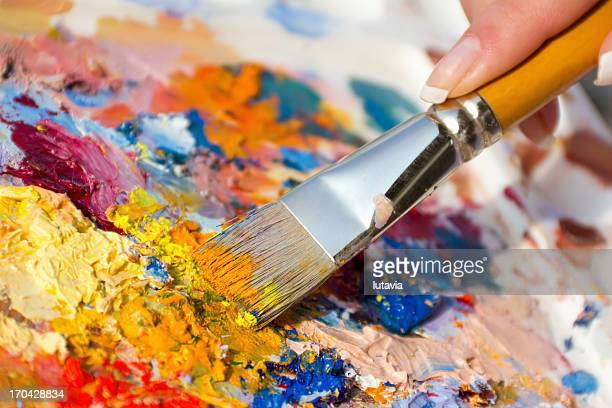 mixing oil paints with a brush