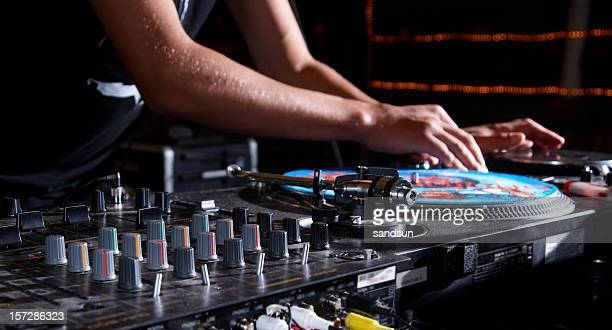 dj mixing some tunes in the club - stage set stock pictures, royalty-free photos & images