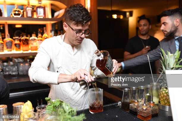 Mixologist Gil Bouhana prepares a cocktail as Fortuna Realty Group opens Sir Henri New York City's first penthouse speakeasy on July 26 2017 in New...