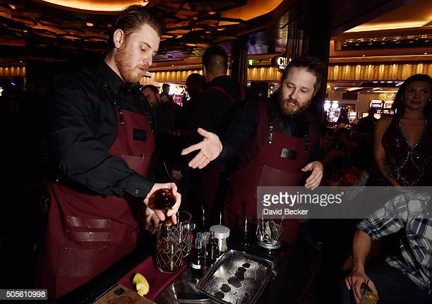 Mixologists Justin D'Angelo and Anthony Sazerac perpare cocktails during the grand opening celebration at Clique Bar Lounge at the Cosmopolitian of...