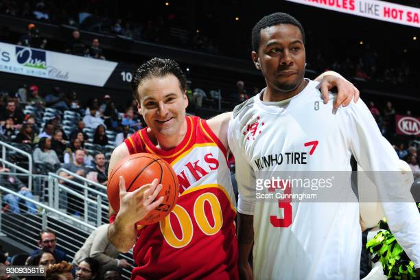 Mixtape legend Hot Sauce challenges Darren Rovell to a 1 on 1 during halftime of the game between the Chicago Bulls and the Atlanta Hawks on March 11...
