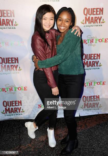 Miya Cech and Lidya Jewett attend Media And VIP Night Queen Mary Christmas held at The Queen Mary on December 6, 2019 in Long Beach, California.