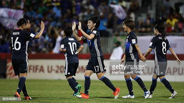 Miyabi Moriya of Japan congratulates Shiho Matsubara of Japan on her second goal during the FIFA U20 Women's World Cup Papua New Guinea 2016 Quarter...