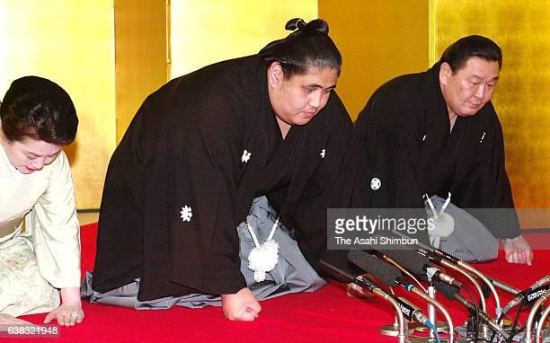 Miyabiyama and his stable master Musashigawa accept the messengers from the Japan Sumo Association delivering his promotion at Musashigawa Stable on...
