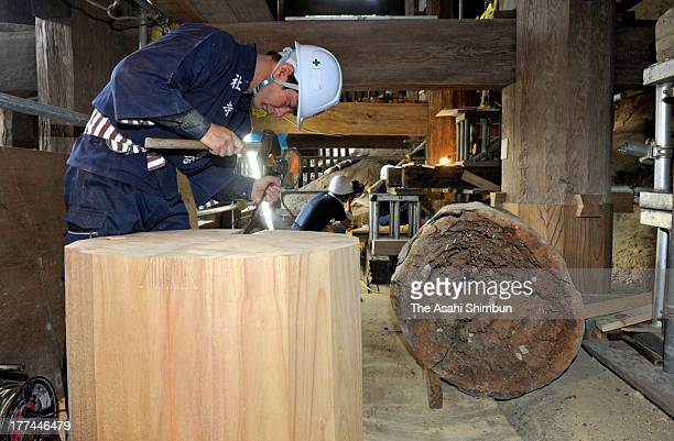 A Miyadaiku carpenter who build and repair traditional buildings such as shrines and temples work to replace the decayed columns of the underneath...
