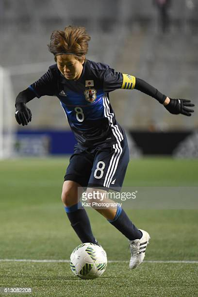 Miyama Aya of Japan dribbles the ball during the AFC Women's Olympic Final Qualification Round match between Australia and Japan at Kincho Stadium on...