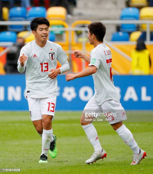Miyashiro of Japan celebrates with his team mate T. Suzuki after scoring his team's third goal during the 2019 FIFA U-20 World Cup group B match...