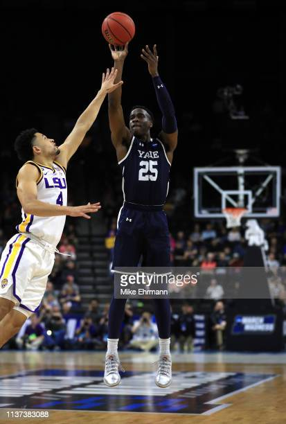 Miye Oni of the Yale Bulldogs takes a shot against Skylar Mays of the LSU Tigers in the first half during the first round of the 2019 NCAA Men's...