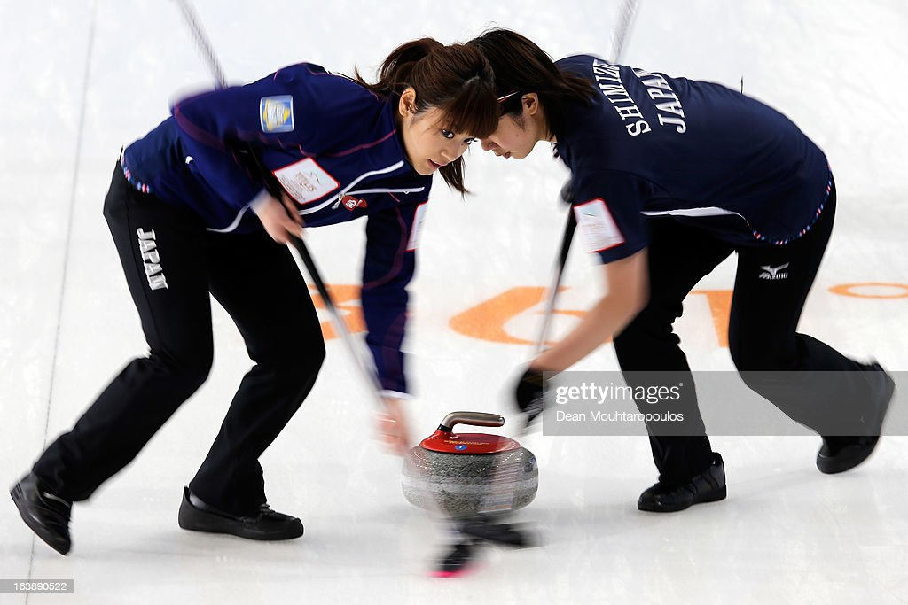 Miyo Ichikawa (L) and Emi Shimizu of Japan sweep in the match between Japan and Latvia during Day 2 of the Titlis Glacier Mountain World Women's Curling Championship at the Volvo Sports Centre on March 17, 2013 in Riga, Latvia.