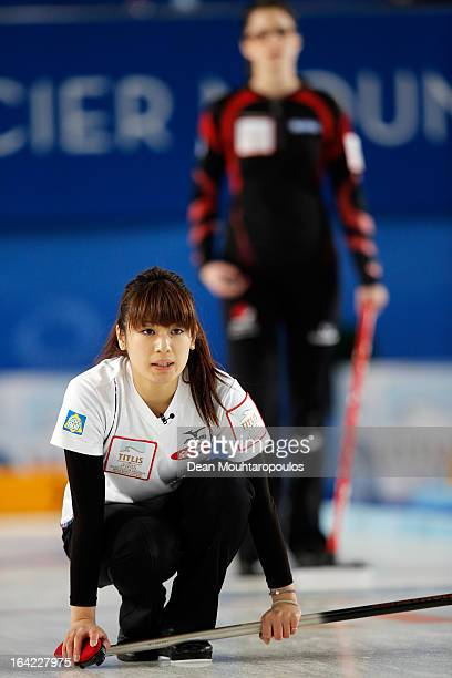 Miyo Ichikawa of Japan looks on after she throws the stone as Lisa Weagle of Canada watches the shot in the match between Japan and Canada on Day 6...