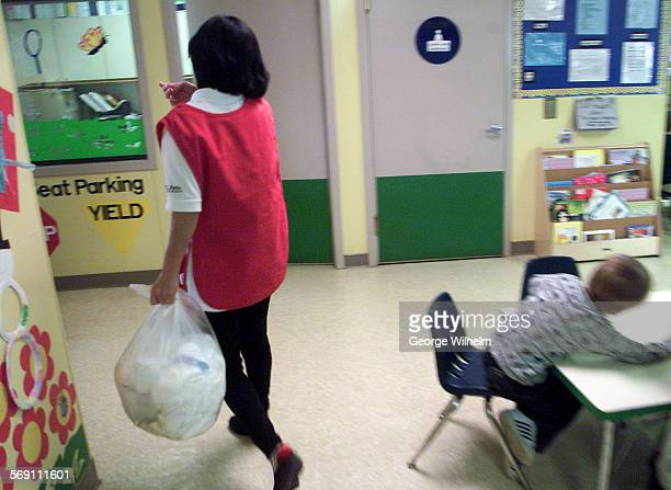 – Miyoko Voorhees who works at La Petite Academy a day care facility in Santa Clarita takes a bag of dirty diapers out to the recycling bin In the...