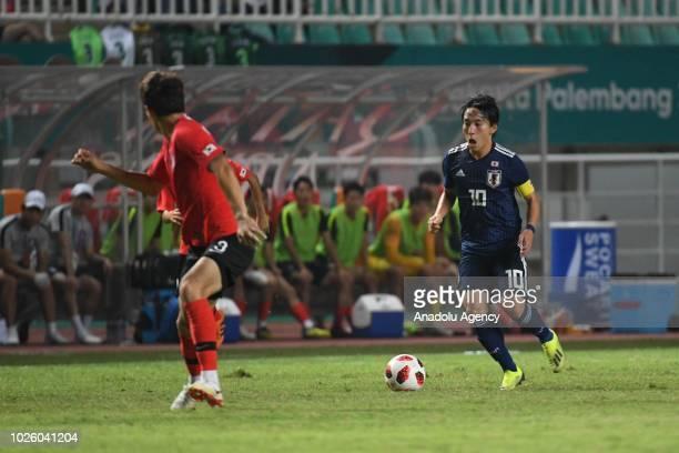 Miyoshi Koji of Japan in action during the 2018 Asian Games Final soccer match between South Korea and Japan at Pakansari Stadium in Bogor, Indonesia...
