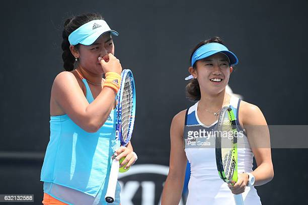 Miyu Kato and Eri Hozumi of Japan compete in their second round doubles match against Alize Cornet of France and Magda Linette of Poland on day five...