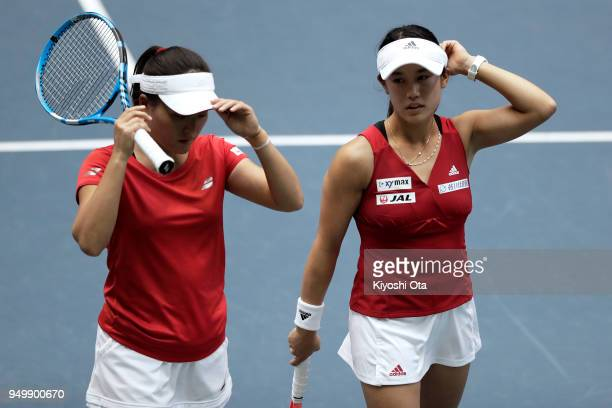 Miyu Kato and Makoto Ninomiya of Japan play in their doubles match against Johanna Konta and Heather Watson of Great Britain during day two of the...