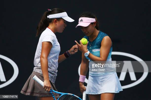 Miyu Kato and Makoto Ninomiya of Japan talk tactics in their first round doubles match against Nao Hibini of Japan and Desirae Krawczyk of the United...