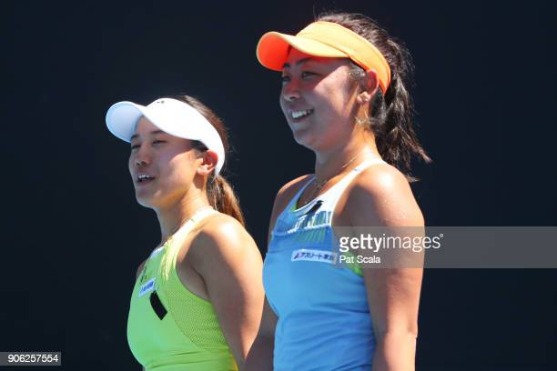 Miyu Kato of Japan and Eri Hozumi of Japan talk tactics in their first round women's doubles match against Storm Sanders of Australia and Monique...