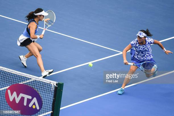 Miyu Kato Of Japan and Makoto Ninomiya of Japan compete against Lyudmyla Kichenok of Ukraine and Nadiia Kichenok Ukraine during their group stage...