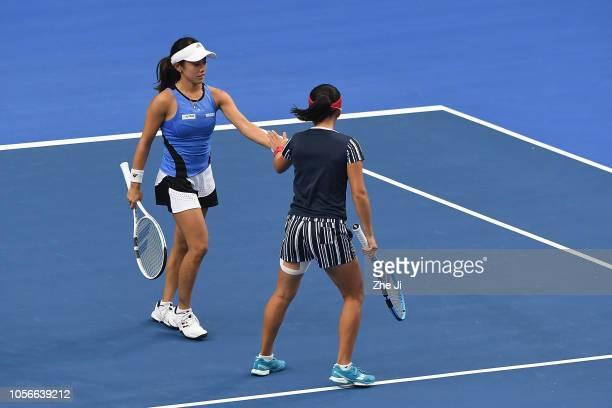 Miyu Kato of Japan and Makoto Ninomiya of Japan in action against Xinyu Jiang of China and Zhaoxuan Yang of China during their women's doubles match...
