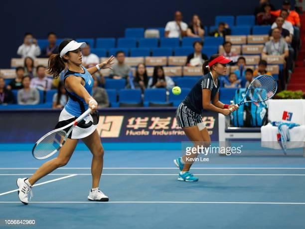 Miyu Kato of Japan and Makoto Ninomiya of Japan in action against Yang Zhaoxuan of China and Jiang Xinyu of China in the fourth round match between...