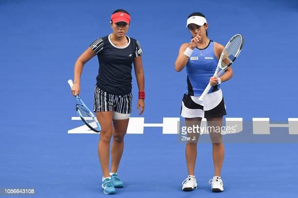 Miyu Kato of Japan and Makoto Ninomiya of Japan return a shot against Xinyu Jiang of China and Zhaoxuan Yang of China during their women's doubles...