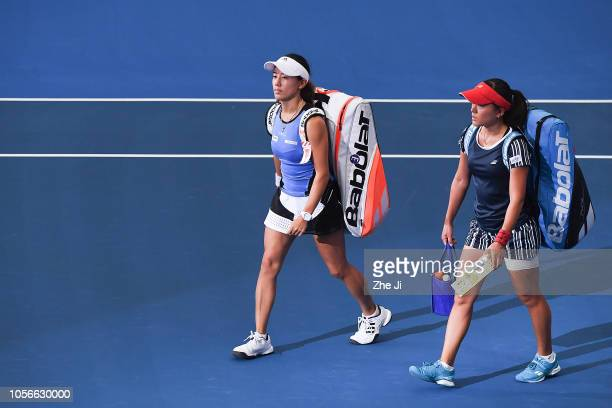 Miyu Kato of Japan and Makoto Ninomiya of Japan walk onto court before their women's doubles match against Xinyu Jiang of China and Zhaoxuan Yang of...