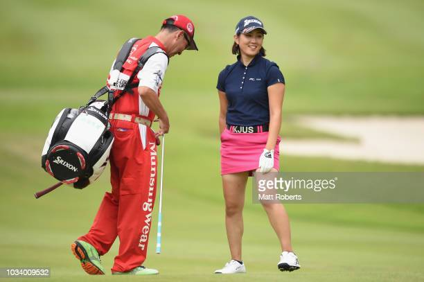 Miyu Shinkai of Japan smiles after her approach shot on the 12th hole during the final round of the Munsingwear Ladies Tokai Classic at Shin Minami...