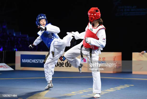 Miyu Yamada of Japan competes against JaeYoung Sim of Korea during day two of the WTF World Taekwondo Grand Prix 2018 at Manchester Arena on October...