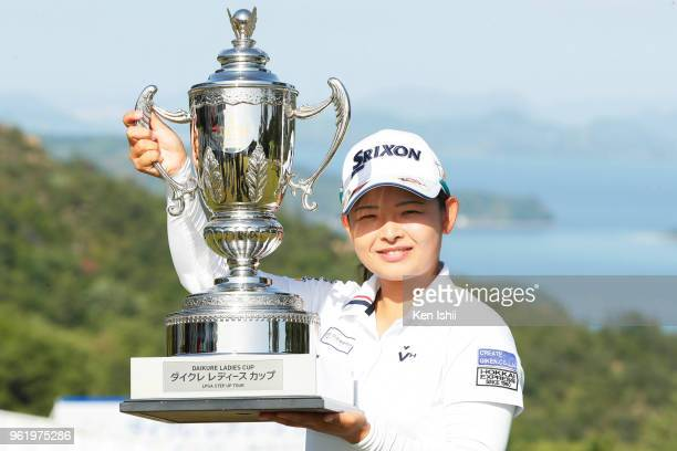 Miyu Yamato of Japan holds the trophy after winning the final round of the Twin Daikure Ladies at the Kure Country Club on May 24 2018 in Kure...