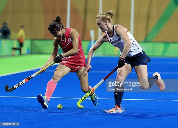 Miyuki Nakagawa of Japan is defended by Nicola White of Great Britain during a Women's Preliminary Pool B match at the Olympic Hockey Centre on...