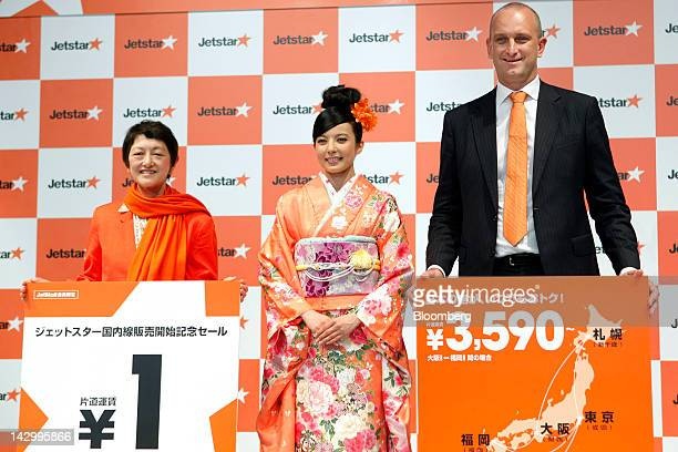Miyuki Suzuki chief executive officer of Jetstar Japan Co left and Bruce Buchanan chief executive officer of Jetstar Airways right pose with actress...