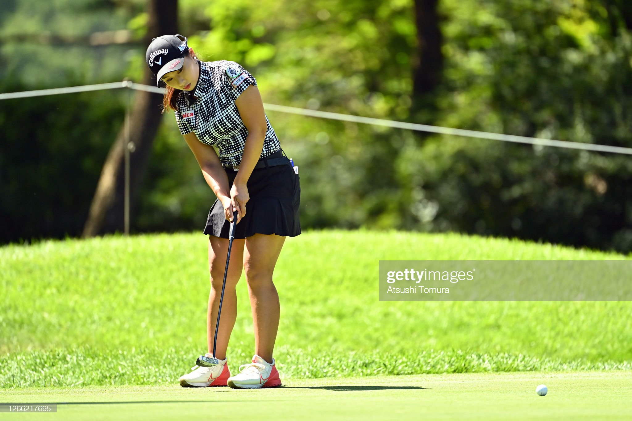 https://media.gettyimages.com/photos/miyuki-takeuchi-of-japan-attempts-a-putt-on-the-9th-green-during-the-picture-id1266217695?s=2048x2048