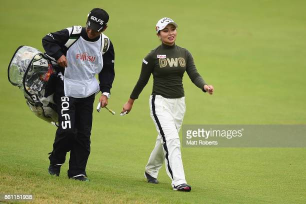 Miyuki Takeuchi of Japan speaks with her caddie during the second round of the Fujitsu Ladies 2017 at the Tokyu Seven Hundred Club on October 14 2017...