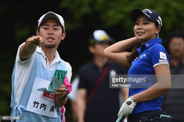 Miyuki Takeuchi of Japan speaks with her caddie on the 10th hole during the first round of the HokennoMadoguchi Ladies at the Fukuoka Country Club...