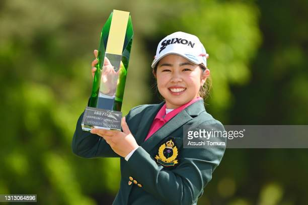 Miyuu Yamashita of Japan poses with the trophy after winning the tournament following the final round of the KKT Vantelin Ladies Open at the Kumamoto...