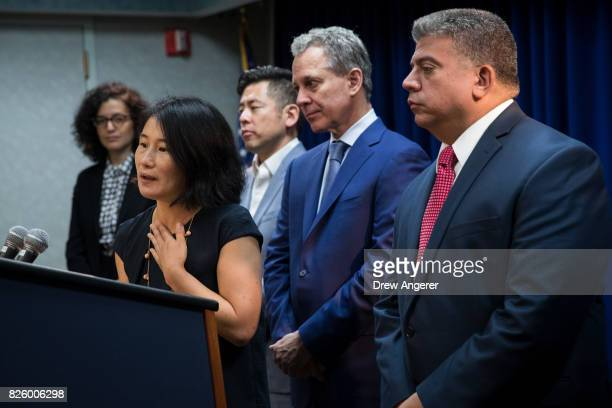 Mizue Aizeki executive director of the Immigrant Defense Project speaks as Steven Choi executive director of the New York Immigration Coalition New...