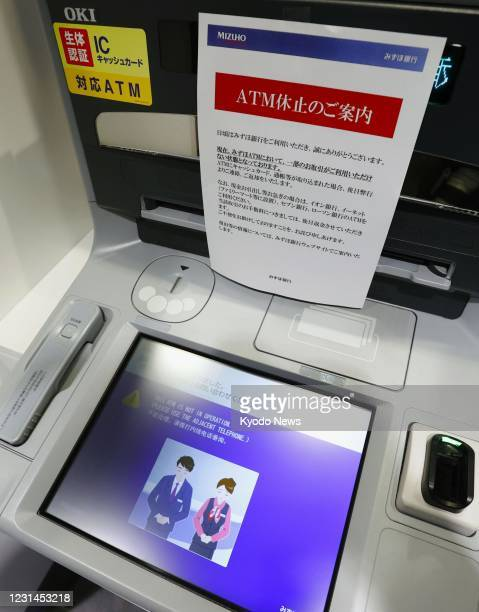 Mizuho Bank ATM is seen out of service in Tokyo on March 1 due to a glitch affecting cash withdrawals and other transactions. Some ATMs of the major...