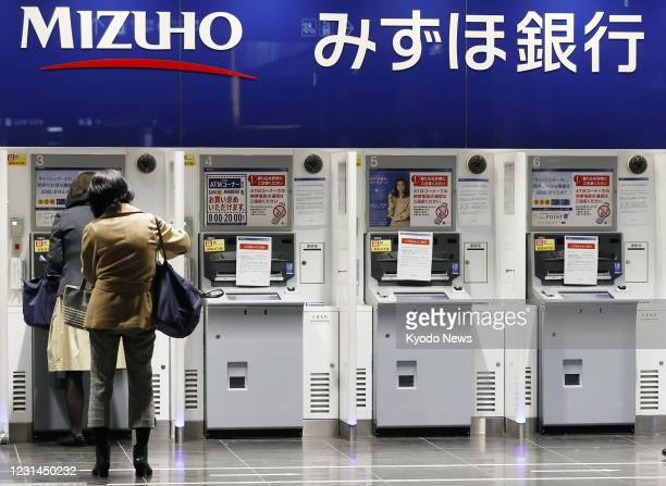 Mizuho Bank ATM services are seen out of service in Tokyo on March 1 due to a glitch affecting cash withdrawals and other transactions. Some ATMs of...