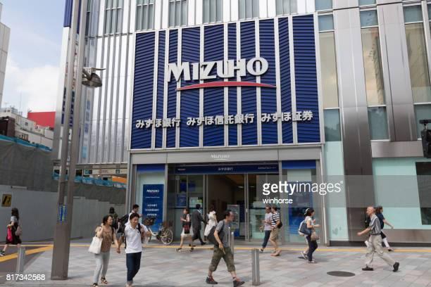 mizuho bank in tokyo, japan - mizuho bank stock pictures, royalty-free photos & images