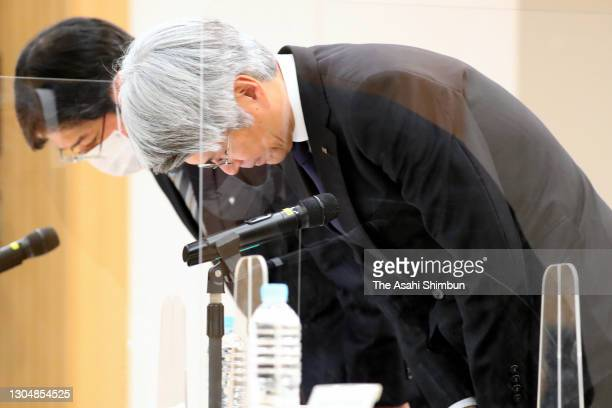 Mizuho Bank President Koji Fujiwara bows for apology during a press conference over a system failure on weekend on March 1, 2021 in Tokyo, Japan.