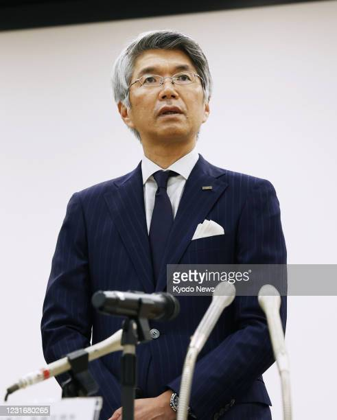 Mizuho Bank President Koji Fujiwara speaks at a press conference in Tokyo on March 12 after the Japanese megabank suffered its fourth system glitch...