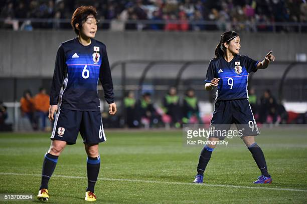 Mizuho Sakaguchi and Nahomi Kawasumi of Japan look on during the AFC Women's Olympic Final Qualification Round match between Japan and China at...