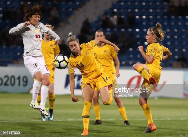 Mizuho Sakaguchi of Japan and Alanna Kennedy of Australia in action during the AFC Women's Asian Cup final between Japan and Australia at the Amman...