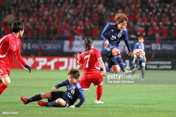 Mizuho Sakaguchi of Japan and Kim Un Hwa of North Korea compete for the ball during the EAFF E1 Women's Football Championship between Japan and North...