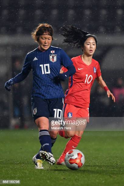 Mizuho Sakaguchi of Japan and Lee Mina of South Korea compete for the ball during the EAFF E1 Women's Football Championship between Japan and South...